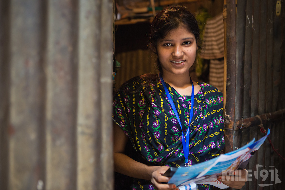 Roxana, a garment worker, outside her home in Dhaka, Bangladesh.<br /> <br /> Roxana is just one of hundreds of workers who are using the LaborVoices SmartLine to share feedback on their safety and working conditions, quickly and anonymously.<br /> <br /> The SmartLine provides brands and suppliers real-time visibility into factory conditions, enabling them to identify and solve problems before they become urgent.