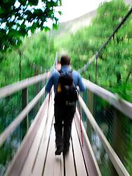 UK SCOTLAND BEN NEVIS 14JUN08 - A hiker sets off on the Three Peaks Challenge Event across a suspension bridge at Ben Nevis in the Scottish Highlands...jre/Photo by Jiri Rezac ..© Jiri Rezac 2008..Contact: +44 (0) 7050 110 417.Mobile:  +44 (0) 7801 337 683.Office:  +44 (0) 20 8968 9635..Email:   jiri@jirirezac.com.Web:    www.jirirezac.com..© All images Jiri Rezac 2008 - All rights reserved.