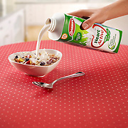 Heart shaped bowl filled with cereal and milk being poured over it Ray Massey is an established, award winning, UK professional  photographer, shooting creative advertising and editorial images from his stunning studio in a converted church in Camden Town, London NW1. Ray Massey specialises in drinks and liquids, still life and hands, product, gymnastics, special effects (sfx) and location photography. He is particularly known for dynamic high speed action shots of pours, bubbles, splashes and explosions in beers, champagnes, sodas, cocktails and beverages of all descriptions, as well as perfumes, paint, ink, water – even ice! Ray Massey works throughout the world with advertising agencies, designers, design groups, PR companies and directly with clients. He regularly manages the entire creative process, including post-production composition, manipulation and retouching, working with his team of retouchers to produce final images ready for publication.
