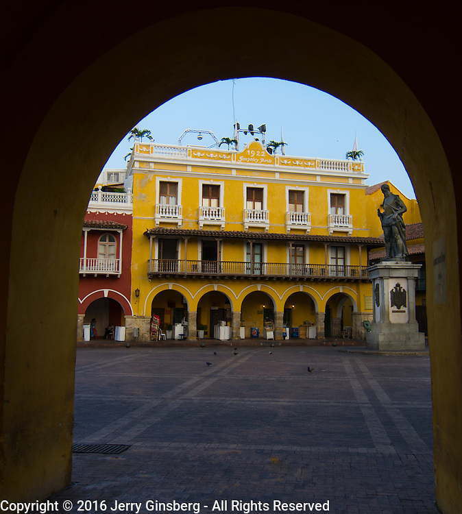 South America, Colombia, Cartagena, <br /> Inviting Puerta Balmaseda opening onto the Plaza de los Coches in historic Cartagena, Colombia.