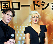 Singer and actress Christina Aguilera (R) and film director Steven Antin attend a red carpet event to promote their film Burlesque in Tokyo, Japan on Dec. 8 2010.