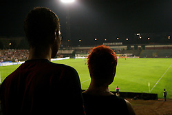 A couple watching a game at Bezigrad stadion for football made by Joze Plecnik in year 1935, before rebuilded in 2008. (Photo by Vid Ponikvar / Sportal Images)..