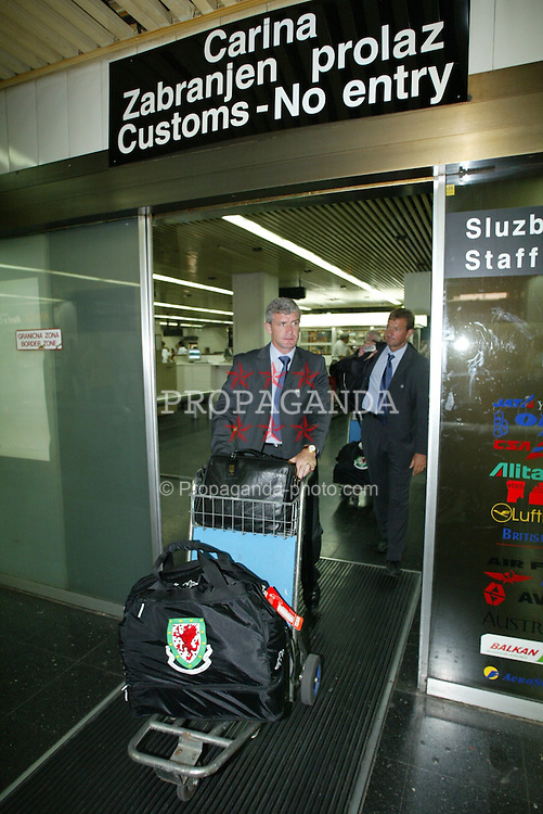 BELGRADE, SERBIA & MONTENEGRO - Monday, August 18, 2003: Wales' manager Mark Hughes arrives at Belgrade Airport ahead of his side's UEFA European Championship Group 9 qualifying match against Serbia & Montenegro. (Photo by David Rawcliffe/Propaganda)