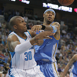 25 March 2009: Denver Nuggets forward Kenyon Martin (4) knocks a pass away from New Orleans Hornets forward David West (30) during a 101-88 loss by the New Orleans Hornets to the Denver Nuggets at the New Orleans Arena in New Orleans, Louisiana.
