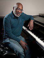Jazz pianist and music professor Darrell Grant poses at the piano in his office at Portland State University.