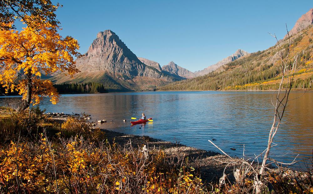 The lone early morning kayaker on Two Medicine Lake. Glacier National Park, Montana,