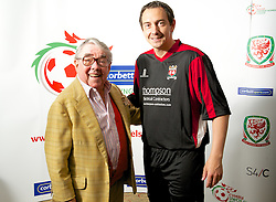 CARDIFF, WALES - Tuesday, August 14, 2012: Prestatyn Town's player manager Neil Gibson with Ronnie Corbett, the sporting ambassador ot Corbett Sport, at the launch the 2012/2013 Welsh Premier League at the St. David's Hotel. (Pic by David Rawcliffe/Propaganda)