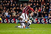 Celtic FC Midfielder Kris Commons and Hearts FC Defender Igor Branco clash  during the Scottish League Cup presented by Ulilita Energy quarter final match between Heart of Midlothian and Celtic at Tynecastle Stadium, Gorgie, Scotland on 28 October 2015. Photo by Craig McAllister.