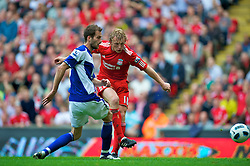 LIVERPOOL, ENGLAND - Saturday, April 23, 2011: Liverpool's Dirk Kuyt scores his side's second goal against Birmingham City during the Premiership match at Anfield. (Photo by David Rawcliffe/Propaganda)