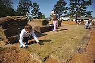 Volunteer Ramsey Frey (left) and Neci Dismukes (center) lay sod at Rivers Hill Park in Oxford, Miss. on Monday, April 22, 2013. Volunteers also installed playground mulch.