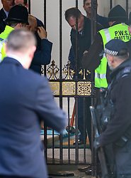 © Licensed to London News Pictures. 18/12/2019 File Picture. State Opening of Parliament rehearsal yesterday 18/12/2019 London, UK. As the Rolls Royce which will be used by the Queen for the first time enters the Houses of Parliament a slight hiccup occurs as the gates became stuck and a sledge hammer had to be used to open them . Photo credit: Alex Lentati/LNP