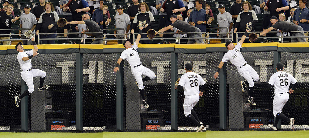 CHICAGO - AUGUST 08:  Adam Engel #41 of the Chicago White Sox leaps over the wall to catch the ball and take away a home run on a ball hit by Brian McCann #16 of the Houston Astros in the fourth inning on August 8, 2017 at Guaranteed Rate Field in Chicago, Illinois.  (Photo by Ron Vesely/)
