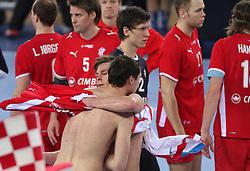 Krzysztof Lijewski (3) of Poland and Hans Lindberg of Denmark  after 21st Men's World Handball Championship 2009 Bronze medal match between National teams of Poland and Denmark, on February 1, 2009, in Arena Zagreb, Zagreb, Croatia.  Won of Poland 31:23. (Photo by Vid Ponikvar / Sportida)