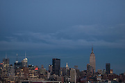 Evenng view of the Manhattan slyline, with the CitiCorp Center, the Chrysler Building, and the Empire State Building, from Hoboken, New Jersey.