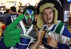 June 4, 2011; Vancouver, BC, CANADA; Vancouver Canucks fans pose for a photo before game two of the 2011 Stanley Cup Finals against the Boston Bruins at Rogers Arena. Mandatory Credit: Jason O. Watson / US PRESSWIRE