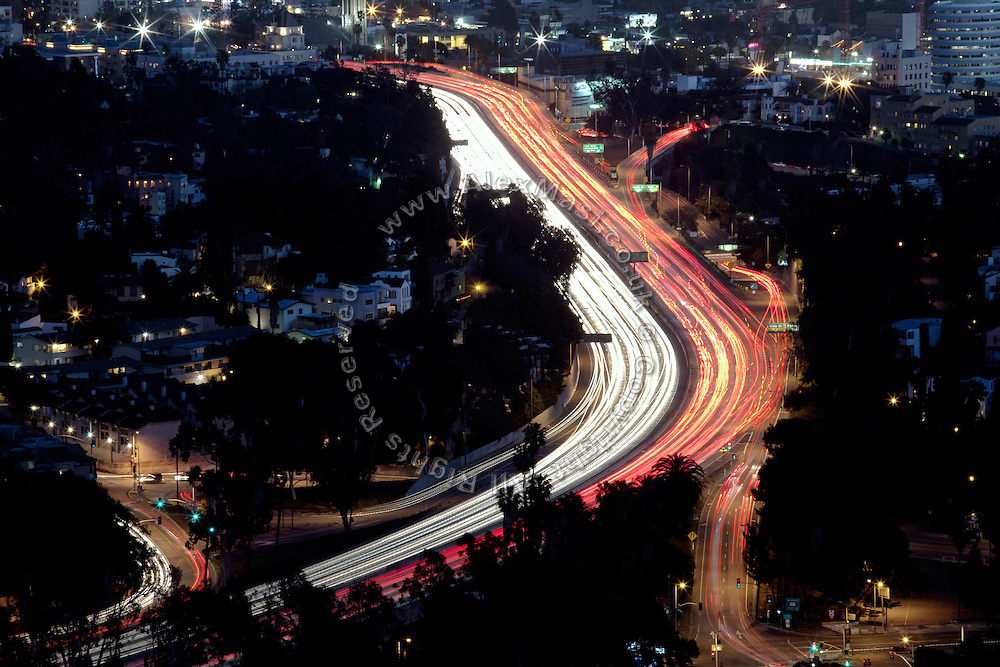 San Diego Freeway (Interstate 405) is busy with cars during the early evening hours in Los Angeles, California, USA.