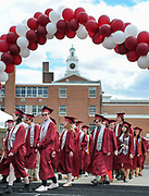 Arlington High School students proceed to their seats during the graduation exercises for the Class of 2017 at the Warren A. Peirce Field in Arlington, June 3, 2017.   [Wicked Local Photo/James Jesson].