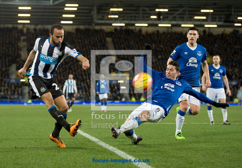 Andros Townsend of Newcastle United (left) has a cross blocked by Bryan Oviedo of Everton during the Barclays Premier League match at Goodison Park, Liverpool<br /> Picture by Russell Hart/Focus Images Ltd 07791 688 420<br /> 03/02/2016