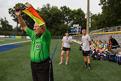 Soccer Linesman Aubrey Cashman, left, signals a team substitution during a soccer match between Lexington Catholic and Henry Clay, Tuesday, Aug. 13, 2013 at Lexington Catholic Soccer/Football Stadium in Lexington. Photo by Jonathan Palmer