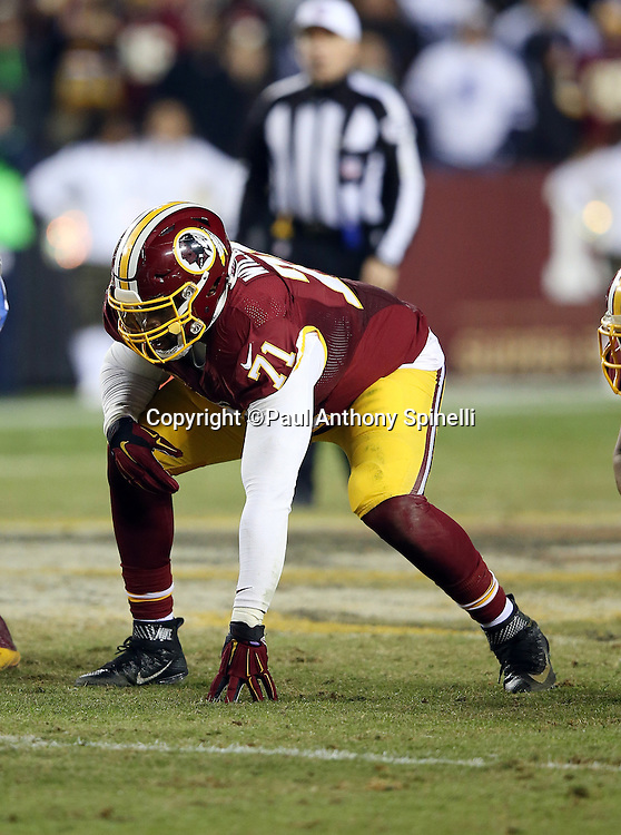 Washington Redskins tackle Trent Williams (71) gets set for the snap during the 2015 week 13 regular season NFL football game against the Dallas Cowboys on Monday, Dec. 7, 2015 in Landover, Md. The Cowboys won the game 19-16. (©Paul Anthony Spinelli)