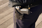 close up of NYC police officer with gun in holster