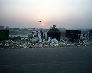 People scavenge through garbage in Hazaribagh, the tannery area of Dhaka.