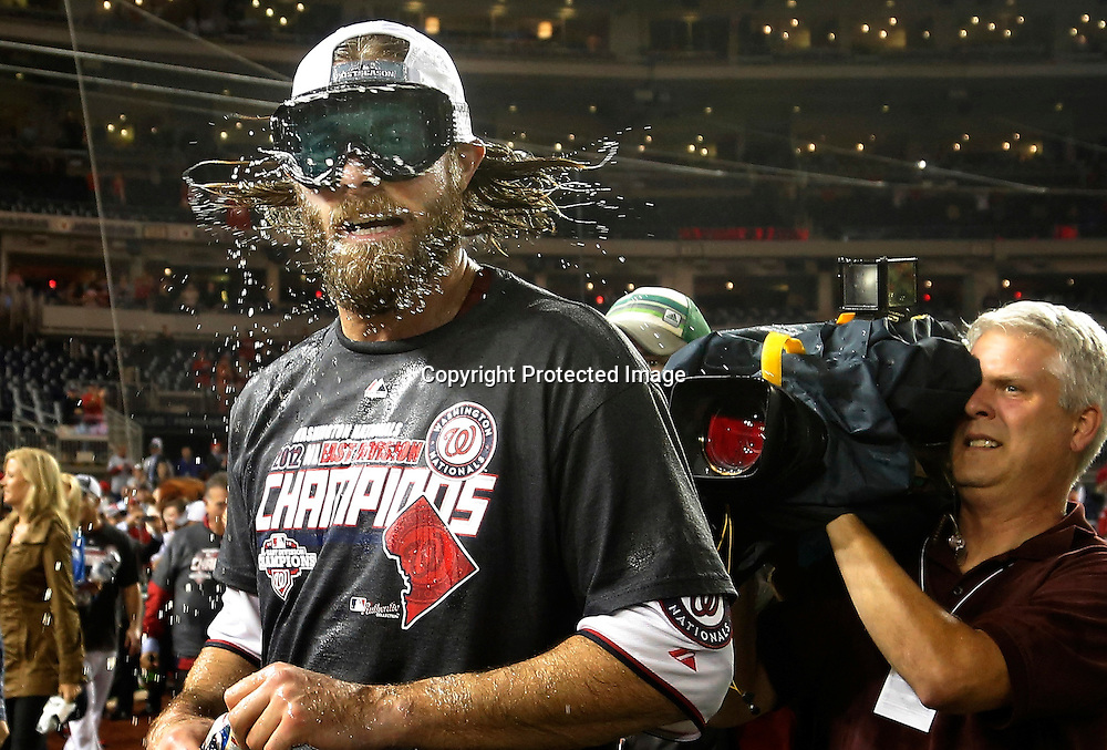 Washington Nationals outfielder Jayson Werth shakes beer and champagne out of his hair celebrates with teammates on the field as the Nationals celebrate their National League East Division championship in their clubhouse at the end of their MLB National League baseball game against the Philadelphia Phillies in Washington.