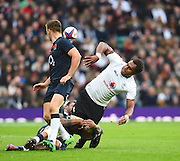 Fijian lock Leone Nakarawa off loads as he is tackled during the Autumn International Series match between England and Fiji at Twickenham, Richmond, United Kingdom on 19 November 2016. Photo by Ian  Muir.