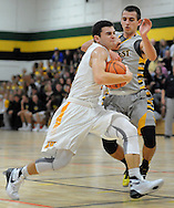 Archbishop Wood's Tommy Funk (3) drives for the basket as Central Bucks West's Luke Irons (10) in the first quarter Saturday December 12, 2015 at Archbishop Wood in Warminster, Pennsylvania. (Photo by William Thomas Cain)