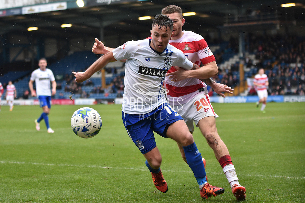 Bury On loan Midfielder,  John O'Sullivan  and Doncaster Rovers Defender, Aaron Taylor-Sinclair battle again during the Sky Bet League 1 match between Bury and Doncaster Rovers at the JD Stadium, Bury, England on 9 April 2016. Photo by Mark Pollitt.
