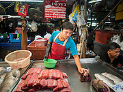 13 MAY 2015 - SAMUT SONGKRAM, SAMUT SONGKRAM, THAILAND:   A butcher in the market in Samut Songkram.    PHOTO BY JACK KURTZ