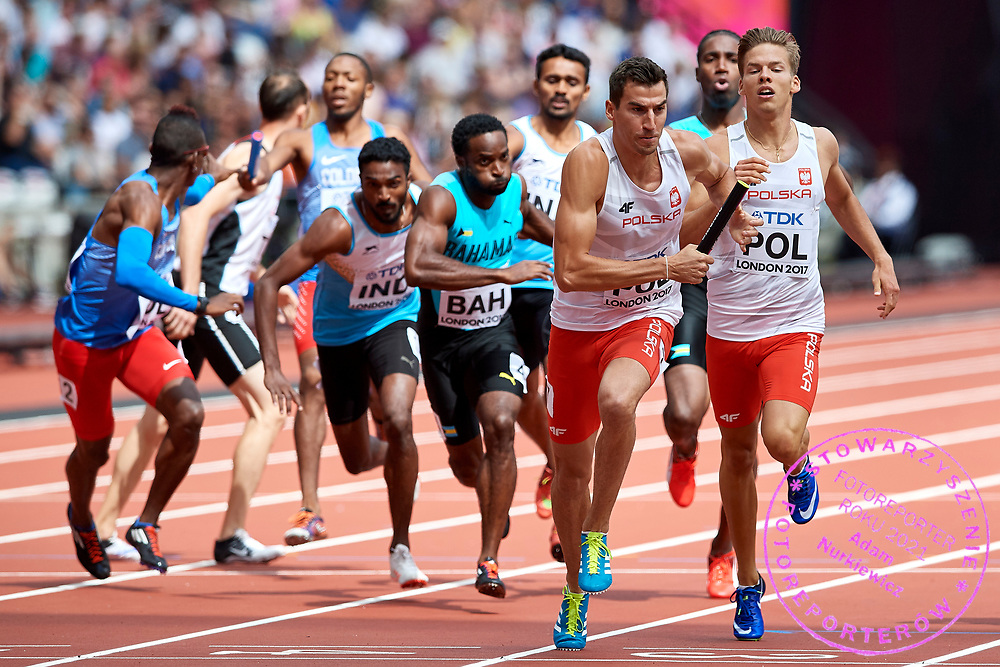 Great Britain, London - 2017 August 12: (L) Rafal Omelko  (AZS AWF Wroclaw) and (R) Tymoteusz Zimny (Baszta Szamotuly) both of Poland compete in men&rsquo;s 4x400 meters relay qualification during IAAF World Championships London 2017 Day 9 at London Stadium on August 12, 2017 in London, Great Britain.<br /> <br /> Mandatory credit:<br /> Photo by &copy; Adam Nurkiewicz<br /> <br /> Adam Nurkiewicz declares that he has no rights to the image of people at the photographs of his authorship.<br /> <br /> Picture also available in RAW (NEF) or TIFF format on special request.<br /> <br /> Any editorial, commercial or promotional use requires written permission from the author of image.