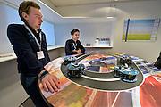 Nederland, Helmond, 25-3-2015Tijdens de automotive week tonen diverse bedrijven en instellingen hun inniovatieve producten of toekomstvisie.De Automotive Campus in Helmond, gelegen in de Brainport Regio rond Eindhoven, is de nationale en internationale hotspot, ontmoetingsplek en vestigingslocatie op het gebied van automotive en slimme mobiliteit. Zij biedt een aantrekkelijke leer- en werkomgeving, en moderne technologische testfaciliteiten.De Campus is een one-stop-shop als het gaat om automotive technologie en mobiliteitsconcepten. De deur staat open voor engineers, toeleveranciers, onderzoekers, testers en assembleerders. Voor innovatie en productontwikkeling. Het is een ontmoetingsplek waar kennis en bedrijven samen komen met als doel het bevorderen van cross-sectorale samenwerking, kennisdeling en open innovatie. Slimme, veilige en duurzame mobiliteitsoplossingen voor mensen, wegen en voertuigen van vandaag en morgen.FOTO: FLIP FRANSSEN/ HOLLANDSE HOOGTE