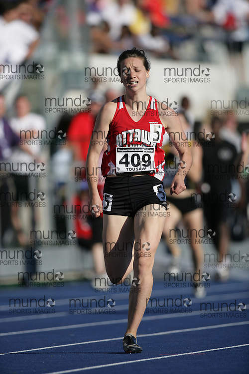 (Toronto, Ontario---26/06/09)   Julia Tousaw competing in  400m heats at the 2009 Canadian National Track and field Championships. Photograph copyright Sean Burges / Mundo Sport Images, 2009. www.mundosportimages.com / www.msievents.