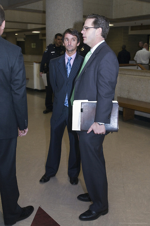 Jockey Robby Albarado speaks with his attorney Scott Barton Tuesday, April 5, 2011 as they prepare to show for arraignment in Jefferson District Court in Louisville, Ky. Albarado was arrested on charges of domestic violence against his wife, Kimber, the previous Thursday night, according to Louisville Police. (Metro Messenger Photo/Brian Bohannon)