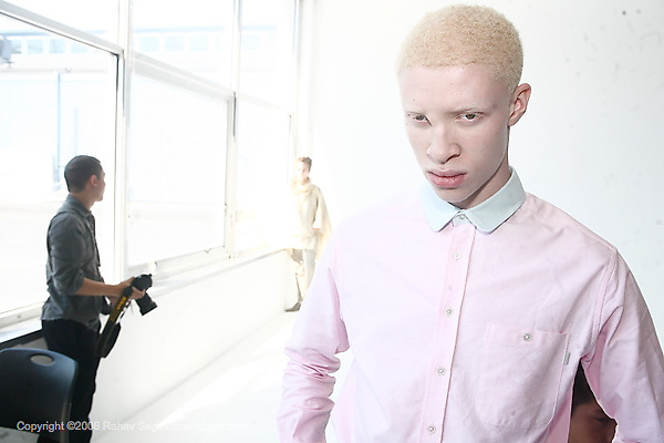 Model Shawn Ross in pink shirt backstage at Patrick Ervell's show is the first albino man working as a runway model shot at Pier 59 Studios on Sunday September 7, 2008. ..Photo Credit; Rahav Segev for The New York Times.