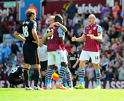 Aston Villa's Phillip Senderos celebrates on the final whistle with Aston Villa's Aly Cissokho and Aston Villa's Alan Hutton - Photo mandatory by-line: Joe Meredith/JMP - Mobile: 07966 386802 31/08/2014 - SPORT - FOOTBALL - Birmingham - Villa Park - Aston Villa v Hull City - Barclays Premier League