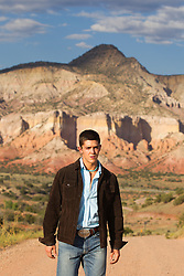 good looking man walking alone in Abiquiu, New Mexico