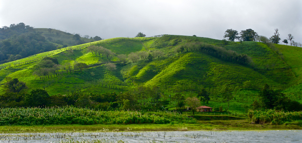 Fields and hills and typical rural home, Costa Rica near Arenal Volcano