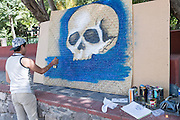 A Mexican graffiti artist paints a skull for Day of the Dead festival in San Miguel de Allende, Guanajuato, Mexico. The week-long celebration is a time when Mexicans welcome the dead back to earth for a visit and celebrate life.