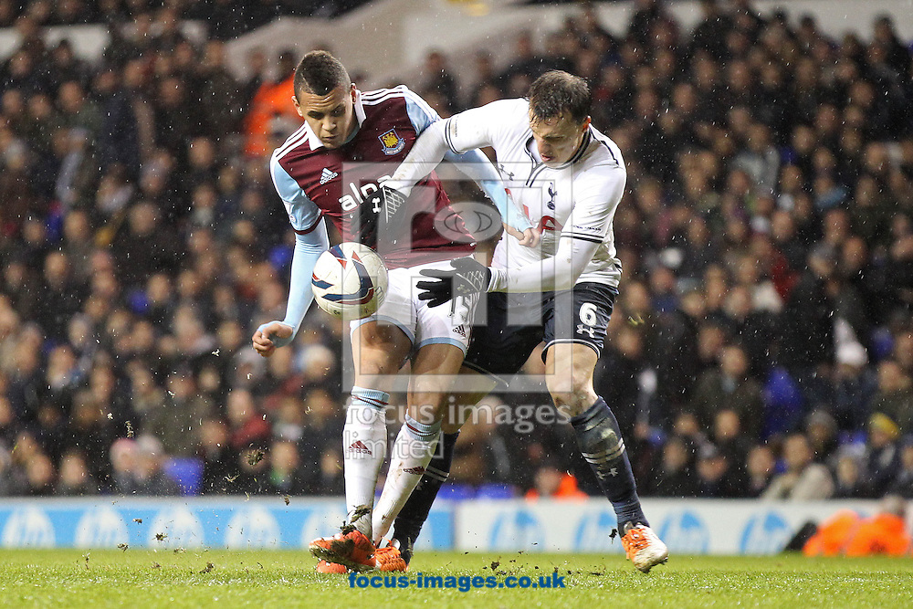 Picture by Paul Chesterton/Focus Images Ltd +44 7904 640267<br /> 18/12/2013<br /> West Ham United's Ravel Morrison and Tottenham Hotspur's Vlad Chiriches in action during the Capital One Cup match at White Hart Lane, London.