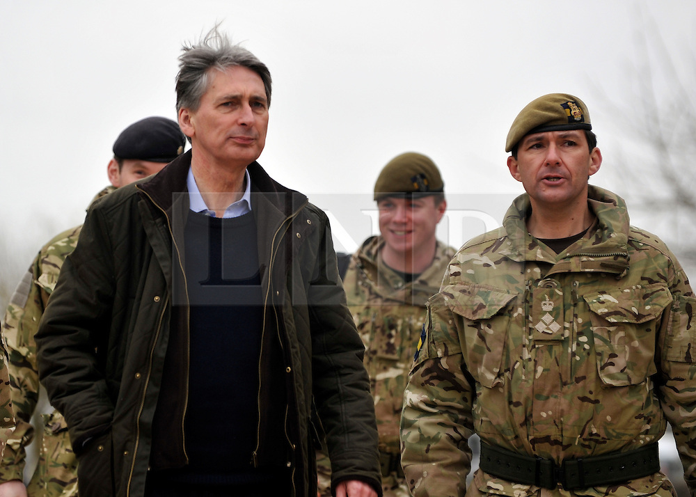 © Licensed to London News Pictures. 09/03/2012. Copedown Hill, UK. Secretary of Defence Philip Hammond talks to Brigadier Doug Chalmers as he visits troops who are being deployed to Afghanistan next month. The 12th Mechanized Brigade (12 Mech Bde) at Copehill Down, Salisbury Plain Training Area, Wiltshire, on FRIDAY 09 MARCH 2012, as it prepares to deploy to Helmand Province, Afghanistan, on Operation Herrick 16, in the Spring of this year. The Brigade were performing a dynamic demonstration of combined Afghan/ISAF operations supported by surveillance assets and casualty evacuation capability. Tornado GR4 fast jest ground support was also displayed.. Photo credit : Stephen SImpson/LNP