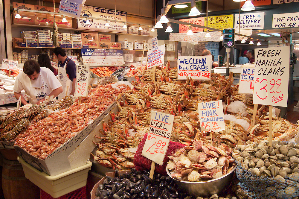 Fresh seafood for sale at Pure Food Fish Market, Pike Place Public Market, Seattle, Washington.