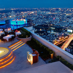 "High-end dining overlooking the Bangkok city lights, Thailand. The restuarant ""Sirocco"" and the illuminated ""Sky Bar"" are on the 64th floor of the State Tower."