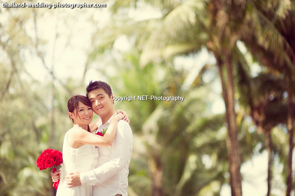 Phuket Thailand - A mixed between engagement session and quick beach ceremony in Phuket, Thailand.<br /> The couple was from Singapore.<br /> <br /> Photo by NET-Photography<br /> Thailand Phuket Wedding Photographer<br /> Phuket Wedding Studio<br /> info@net-photography.com<br /> <br /> View this album on our website at http://thailand-wedding-photographer.com/wedding-phuket-thailand-phuket-beach/?utm_source=photoshelter&amp;utm_medium=link&amp;utm_campaign=photoshelter_photo