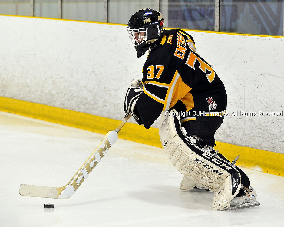 TORONTO, ON - Apr 13: Ontario Junior Hockey League, Buckland Cup Championship Series between the Aurora Tigers and the Toronto Patriots. Kevin Entmaa #37 of the Aurora Tigers passes the puck during second period game action.<br /> (Photo by Shawn Muir / OJHL Images)