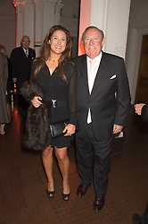 ANDREW & SUSAN NEIL at a dinner to celebrate Sir David Tang's 20 year patronage of the Royal Academy of Arts and the start of building work on the Burlington Gardens wing of the Royal Academy held at 6 Burlington Gardens, London on 26th October 2015.