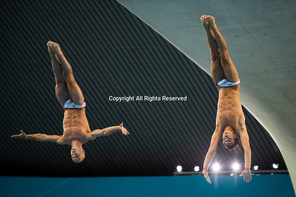 30.07.2012. London, England. Britains Peter Waterfield (GBR) and Thomas Daley (GBR) compete in the Mens Synchronised 10m Platform Diving Final on Day 3 of the London 2012 Olympic Games at the Aquatics Centre on the Olympic Park.