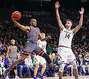 SOUTH BEND, IN - JANUARY 12: Wynston Tabbs #5 of the Boston College Eagles passes the ball off against Nate Laszewski #14 of the Notre Dame Fighting Irish at Purcell Pavilion on January 12, 2019 in South Bend, Indiana. (Photo by Michael Hickey/Getty Images) *** Local Caption *** Wynston Tabbs; Nate Laszewski