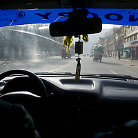 APRIL 4, 2012 : the street where Sonam Dargye, 43, is seen through a car screen in Tongren .